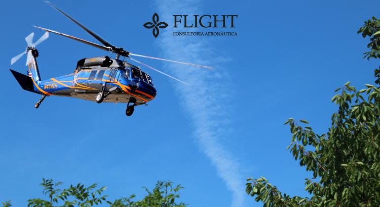 Na foto, um exemplo de helicóptero com rodinhas - ideal para deslocar a aeronave no solo.